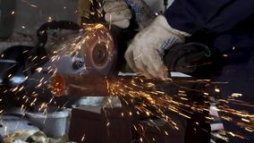 Heavy industry worker cutting steel with angle grinder, high-speed video. Frame. Worker with angle grinder and. Heavy industry worker cutting steel with angle stock video