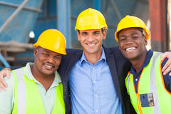 Heavy industry workers. Happy heavy industry manager and workers portrait Royalty Free Stock Images