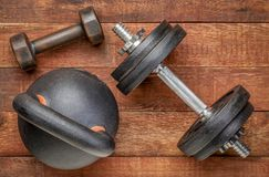 Heavy iron kettlebell and dumbbells - fitness concept royalty free stock photo