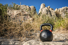 Heavy iron kettlebell with tumbelweed Royalty Free Stock Images