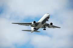 Heavy jet approaching airport Royalty Free Stock Photography
