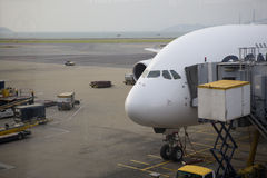 Heavy jet at the Gate at Hong Kong International Airport. Jet airliner at the gate at Hong Kong International Airport. Image shows the front of the plane, with stock photography