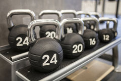 Heavy kettlebells weights in a workout gym Royalty Free Stock Image