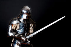Heavy knight in combat position Stock Images