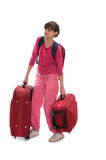 Heavy lagguages. Young teenager carry heavy huge luggages Stock Photo