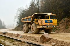 Heavy large quarry dump truck. The work of construction equipment in the mining industry. Production useful minerals. Sand transportation royalty free stock images