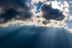 Heavy leaden sky with breaking sun rays. Heavy dark leaden sky with breaking sun rays Stock Image