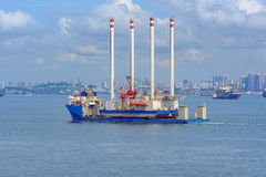 Heavy lift cargo ship transporting an oil rig platform. Oil rig platform transportation by heavy lift vessel on the Singapore Strait stock photography