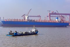 Heavy lift cargo ship transporting an ship sections. Heavy lift cargo vessel carries the prefabricated details of the ship's set along the newly building royalty free stock photography