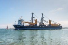 Heavy Lift Carrier Vessel Calypso. Rostock, Germany - May 26, 2017: Heavy Lift Carrier Vessel Calypso leaves the port of Warnemunde, Hanseatic City Rostock stock photo