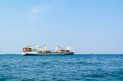 Heavy lift ship with cargo on North Sea near port of Rotterdam, Royalty Free Stock Photography