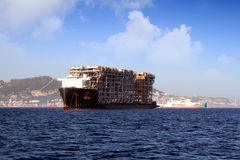 Giant heavy-lift ship RED ZED 2 anchored in Algeciras bay. Heavy-lift ship RED ZED 2 designed to move very large loads that cannot be handled by normal ships in stock photography