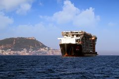 Giant heavy-lift ship RED ZED 2 anchored in Algeciras bay. Heavy-lift ship RED ZED 2 designed to move very large loads that cannot be handled by normal ships in stock photos