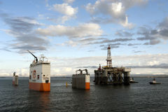 "03.08.2014 - The heavy lift vessel Dockwise Vanguard offloading the Semi-Submersible rig ""Ocean Patriot"", outside Edinburgh. Stock Image"