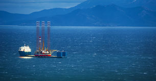 Heavy lift vessel. A heavy lift vessel loaded with a jack up rig stock photos