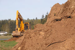 Heavy Lifters and Moving Earth Royalty Free Stock Image