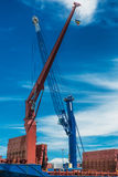 Heavy lifting crane on the vessel and commercial port Stock Image