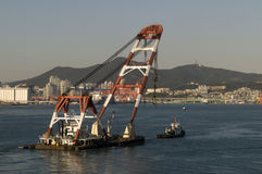 Heavy lifting floating crane Stock Images