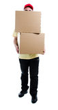 Heavy load. Delivery man holding two heavy boxes Royalty Free Stock Image