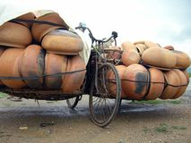 Heavy Load. Bike used to carry ceramic pot in Central Vietnam Stock Photo
