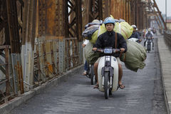 Heavy load on the bike Stock Photos
