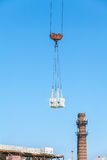 Heavy load hanging on construction site of brick building Stock Images