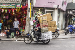 Heavy load on a motorbike Royalty Free Stock Images