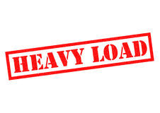 HEAVY LOAD. Red Rubber Stamp over a white background Stock Photography