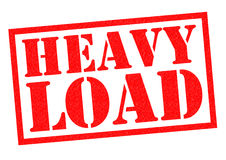 HEAVY LOAD. Red Rubber Stamp over a white background stock illustration