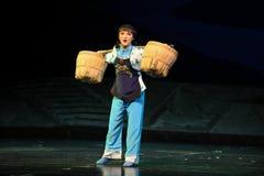 The heavy load of woman- Jiangxi opera a steelyard Stock Image