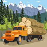 Heavy loaded logging truck in forest in mountains Stock Photography