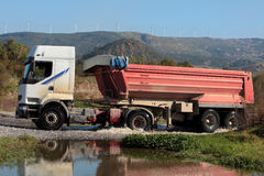 Heavy lorry or truck drives through small river. A large truck drives through a small river in the Spanish countryside Royalty Free Stock Photos