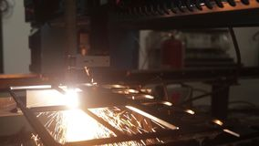 Heavy machine in work. Sparks and factory equipment at work stock video footage