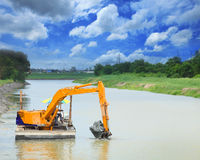 Heavy Machine Working In Canal Stock Photography