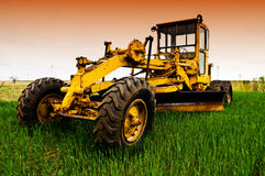 Heavy machinery. Farming equipment in the field at sunset Royalty Free Stock Photos