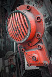 Heavy Machinery. A red attachment bolted to a piece of heavy machinery Stock Images