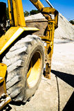 Heavy machinery. To work hard on machines that are filled with soil Royalty Free Stock Images