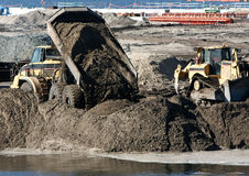 Heavy machinery on construction site stock photography