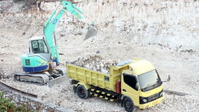 Heavy Machinery 3 of 4 - Digger Excavator Loads Truck stock video footage