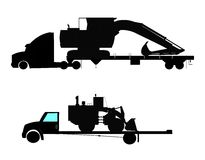 Heavy machinery on flatbeds Stock Images