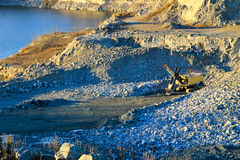 Heavy machinery in a granite quarry Royalty Free Stock Images