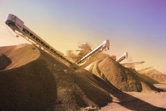 Heavy machinery of gravel production in quarry Royalty Free Stock Photography
