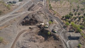 Gravel and sand quarry. Heavy machinery at gravel and sand quarry. extraction volcanic sand at sorting crushing complex. rock crushing and screening equipment stock video footage