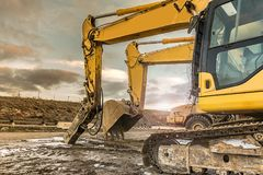 Heavy machinery in a hard day of work in the construction of a road stock photo