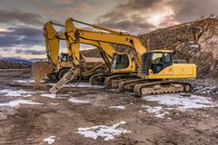Heavy machinery in a hard day of work in the construction of a road. Building a path through the mud stock photography
