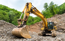 Heavy machinery in quarry. Old, heavy rusty machinery in quarry Royalty Free Stock Images
