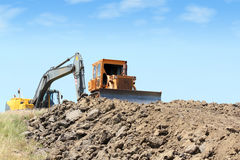 Heavy machinery on road construction. Bulldozer heavy machinery on road construction Stock Photography