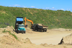 Heavy machinery in a sandpit. POLEWOJE, KALININGRAD REGION, RUSSIA — JUNE 18, 2014: Heavy machinery in a sandpit Royalty Free Stock Images