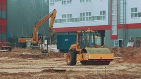 Heavy machinery working on construction site. Tandem vibration roller compactor stock video