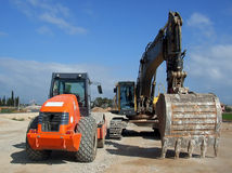 Heavy Machines. Industrial vehicles ready to work in a new road construction Royalty Free Stock Image
